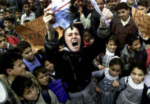 Rachel Corrie at a rally in southern Gaza, burning a mock U.S. flag in ...