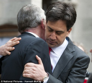 Emotional: Margaret Beckett cries as she is accompanied by Ed Miliband ...