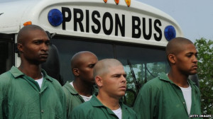 Are there more US black men in prison or college?