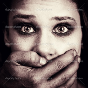 Scared woman victim of domestic torture and abuse - Stock Image