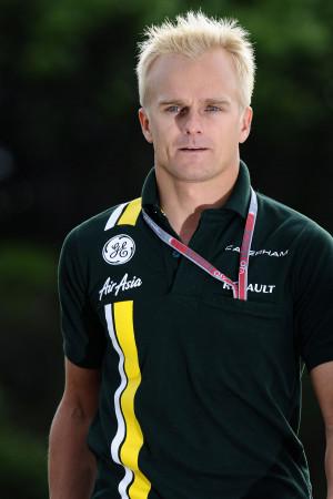 Heikki Kovalainen arrives in the paddock