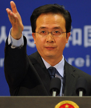 China's Ministry of Foreign Affairs spokesman Hong Lei gestures at a ...