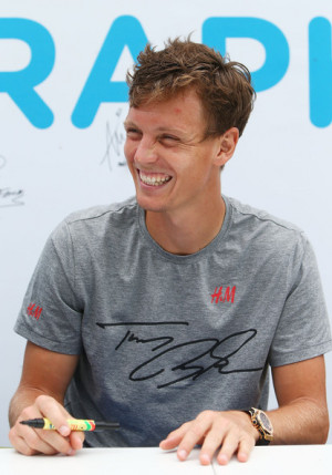 Tomas Berdych Tomas Berdych of the Czech Republic signs his autograph