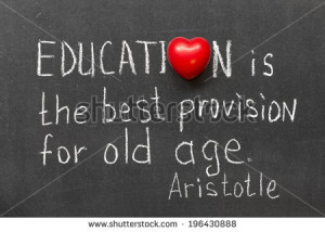 ... quote about education handwritten on blackboard - stock photo