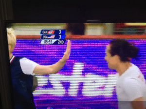 Megan Rapinoe Puts Up Her Hand to the Face of Canadian Player