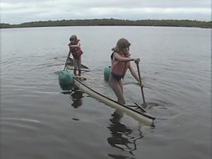 young summer kid happy girl fun female child kayaking kayak canoe