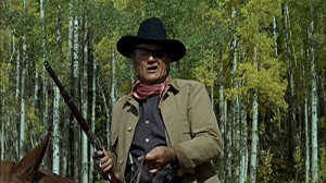 ... Wayne as one-eyed marshal Rooster Cogburn, one of his signature roles