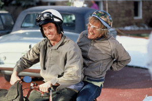 dumb and dumber riding on the scooter in aspen