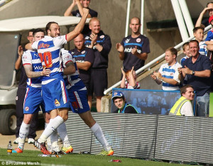 Glenn Murray wheels away in delight with his Reading team-mates after ...