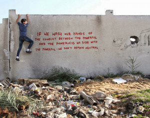 Banksy Secretly Gets Into Gaza To Create Controversial Street Art