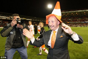 Mad as a hatter: Holloway celebrates reaching the Championship play ...