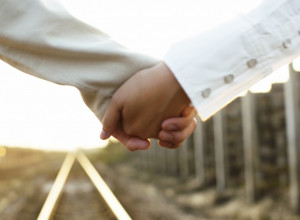 Couple Holding Hands on a Railroad Track — Image by © Royalty-Free ...