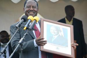Minister Raila Odinga auctioning President Yoweri Kaguta Museveni ...