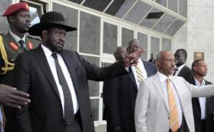 South Sudan's President Salva Kiir Mayardit (L) gestures as he leaves ...