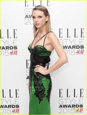 About This Photo Set: Taylor Swift shows off her leg in a green dress ...