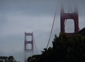 The Golden Gate bridge emerges from fog, seen from The Lodge at ...