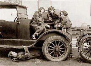 High school girls learn the art of automobile mechanics