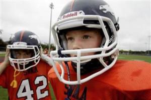 Despite warnings of head injuries, youth football still thrives