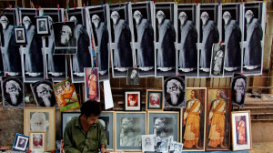 street vendor sells photographs of Indian poet Rabindranath Tagore ...