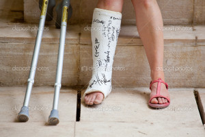 Woman with leg in plaster and crutches — Photo by bepsimage