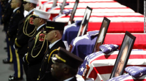 firefighters honor guard stands before the coffins of fallen ...