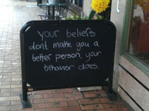 ... of an inspirational quote on a chalkboard about behavior and beliefs