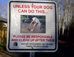 funny sign dog cleaning poop