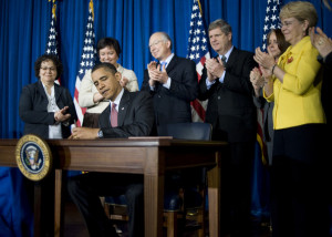 Ken Salazar President Barack Obama signs a memorandum after delivering