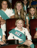 Dakota with her new sister Girl Scouts at an exclusive screening of ...