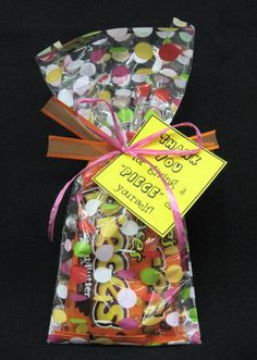 Reeses Pieces candy bags tied up with a tag that says: Thank you for ...