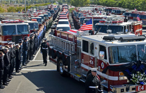 firefighters lined an Irvine, Calif., street Wednesday for the funeral ...