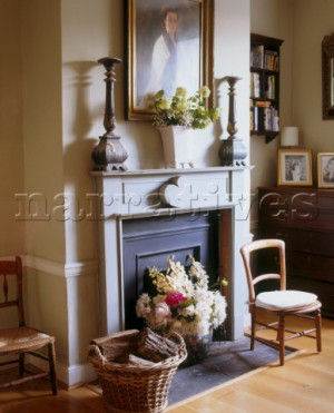 traditional sitting room fireplace with a large display of flowers