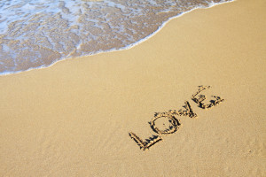 Love word written in the sand