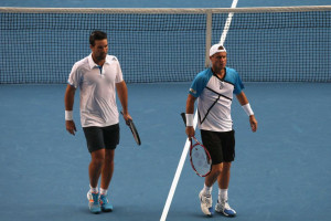 Early exit ... Lleyton Hewitt (R) and Pat Rafter during their doubles ...