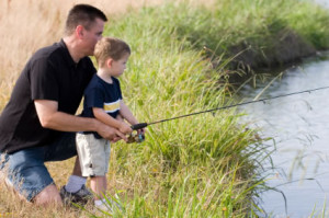Return to dad teaching his son to fish