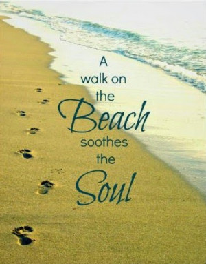 in the sand as she walks along the beach canvas