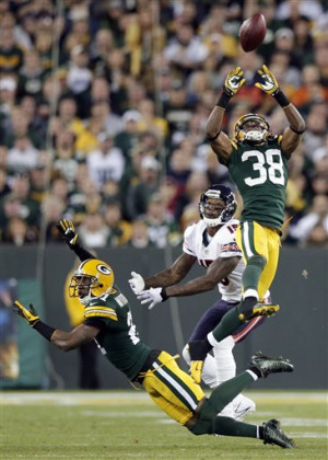 Green Bay Packers' Tramon Williams intercepts a pass in front of ...