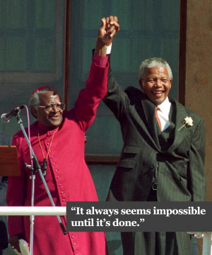 Archbishop Desmond Tutu introduces Nelson Mandela to the crowd at the ...