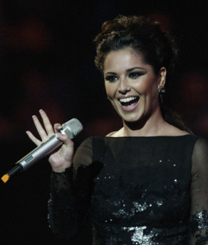 British singer Cheryl Cole arrives on stage to present Rihanna with ...