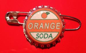 Young Ellie Up Pixar Orange soda ellie badge