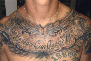 Only God Can Judge Me Quote Tattoo On Chest