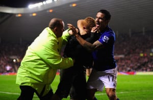 Tim Cahill Everton player Tim Cahill r and a fan celebrate the