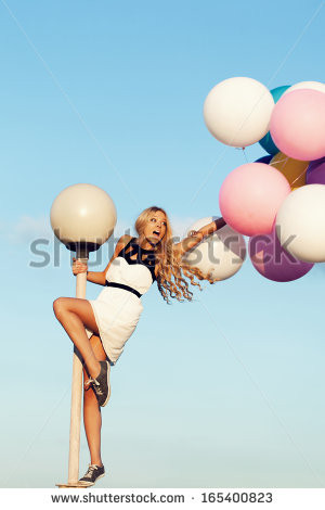 ... young girl with big colorful latex balloons . Beauty Romantic