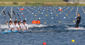 Rowers paddle fast enough to pull a wakeboarder