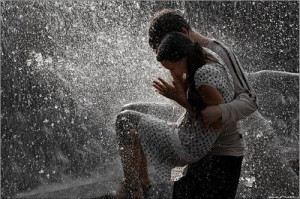 Cute couples playing in rain