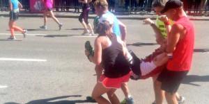 boston-marathon-runner-falls-down-gets-carried-across-the-finish-line ...