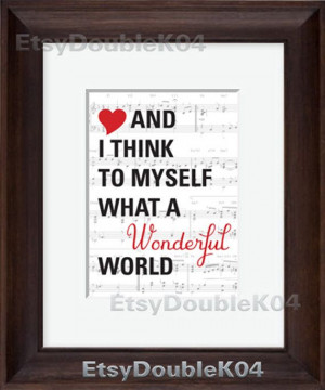 What a Wonderful World Quote with a Sheet Music background