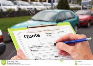 Hand with pen writing a quote or estimate for car repairs.