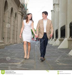 young-couple-walking-hand-hand-25621191.jpg
