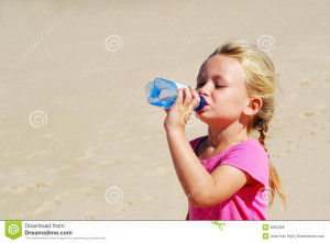 cute little caucasian thirsty girl child drinking still cold water ...